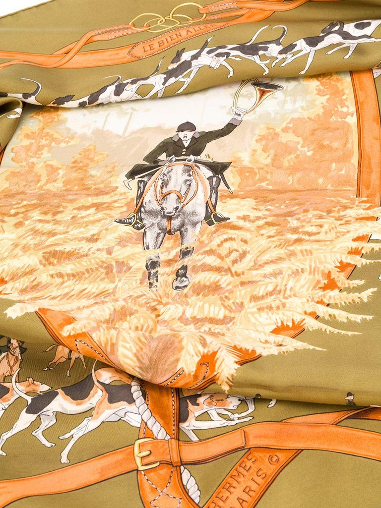 Crafted in France from the finest silk in a colourful palette of olive green, gold and brown, this pre-owned scarf by Hermès features a lightweight construction, a square shape and an elegant, all-over 'fox hunt' motif print. The piece is delicately