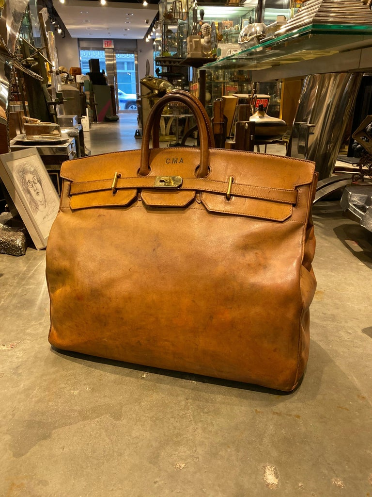 For your consideration is one of the most rare, and spectacular bags we have ever come across. This bag is in incredible structural condition, with many years of life left it. From the handles to the body, this bag has developed a perfect patina. At
