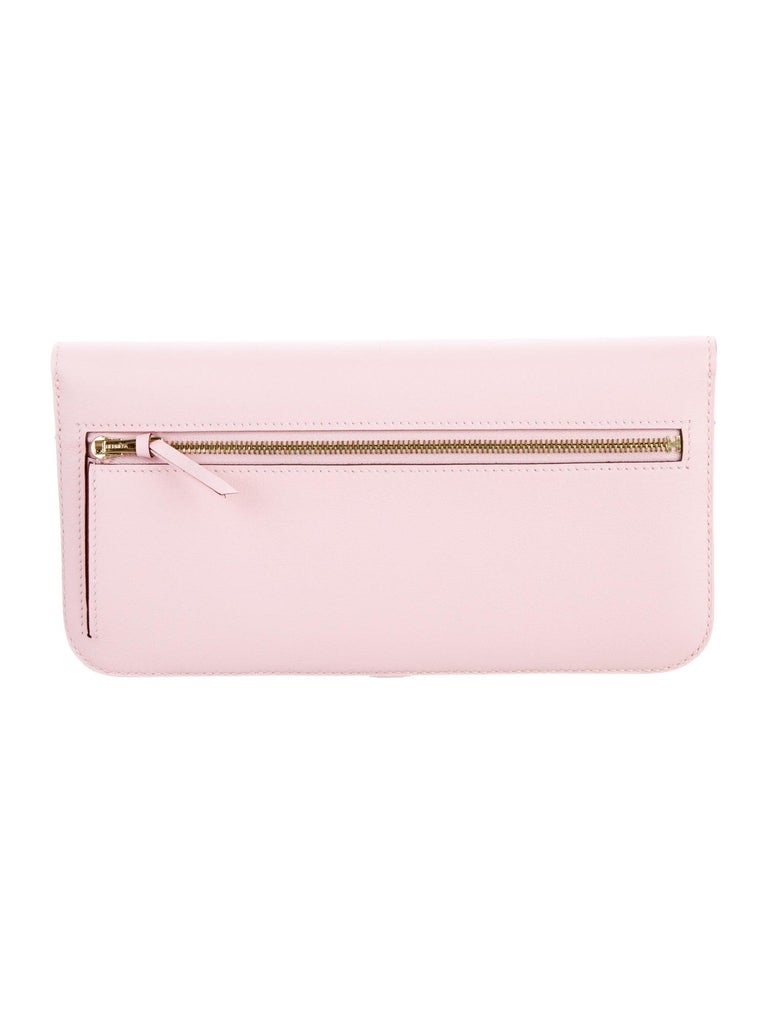 Hermes Light Pink Leather Gold Envelope Evening Clutch Wallet in Box  Leather  Gold-plated hardware Leather lining Belted turnlock closure Features twelve card slots  Measures 8