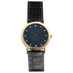 Hermès Limited Edition 18 Karat Gold and Diamond Watch