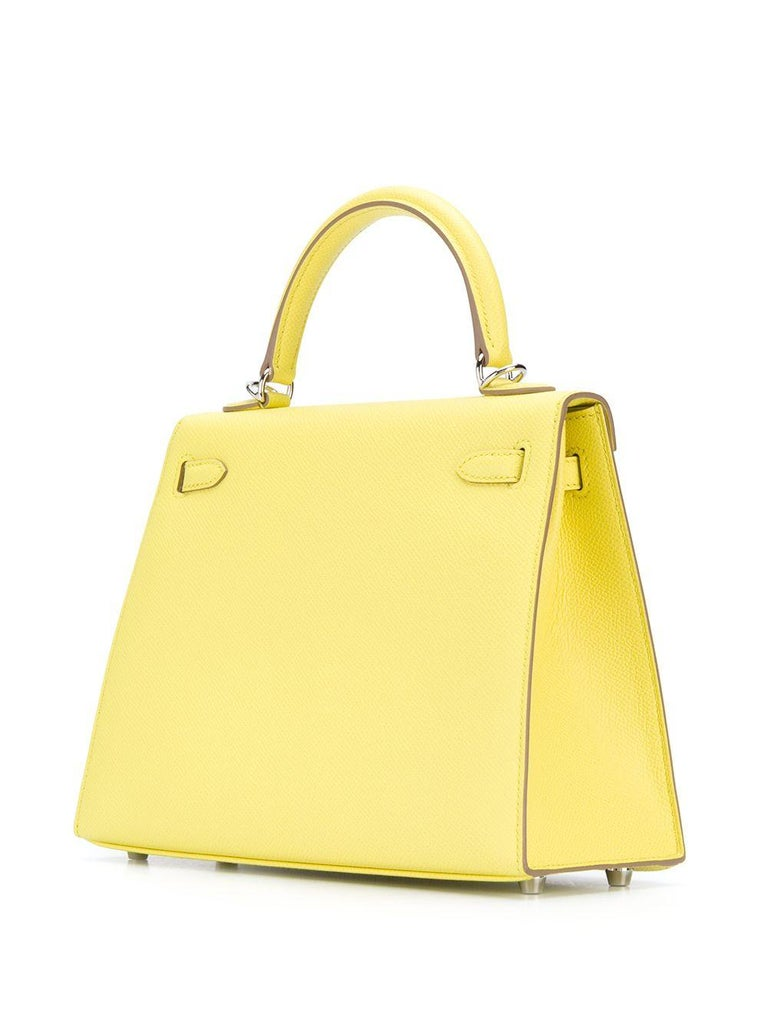 In a highly sought-after compact size, this Hermès Candy Kelly 25 bag makes an irresistibly feminine statement. Expertly crafted in France from a supple lime green epsom leather, hand stitched by skilled craftsmen in a contrasting white and