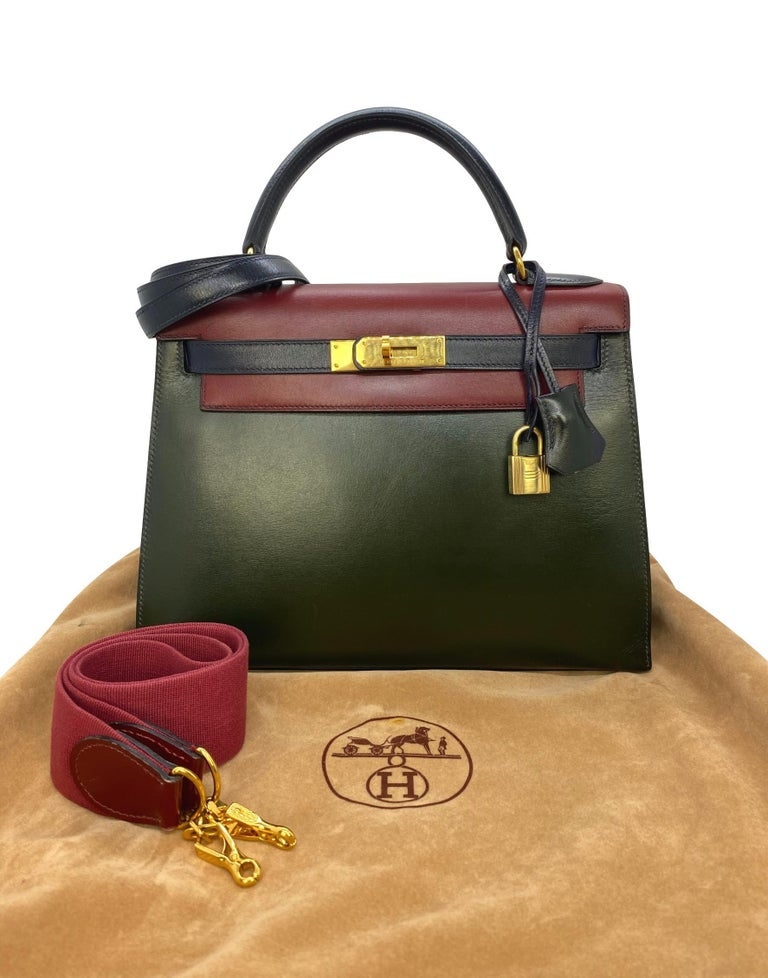 Hermès Limited Edition Vintage Tri-Color Vert Fonce, Rouge H & Indigo Box Calf Kelly Bag with Gold Hardware 28, 1993. Originally introduced in the early 1930's as the Sac à dépêches bag, the Kelly became world renowned after Grace Kelly, Princess