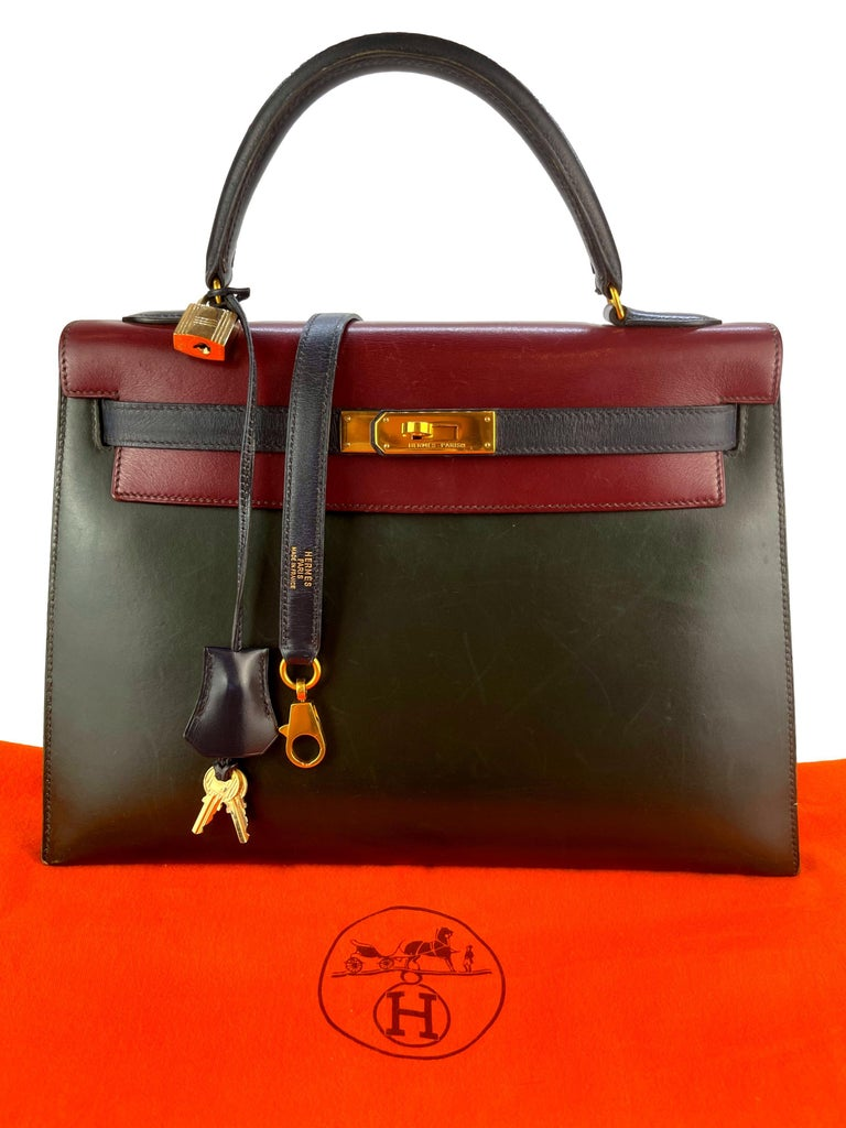 Hermès Limited Edition Vintage Tri-Color Vert Fonce, Rouge H & Indigo Box Calf Kelly Handbag with Gold Hardware 32, 1991. Originally introduced in the early 1930's as the Sac à dépêches bag, the Kelly became world renowned after Grace Kelly,