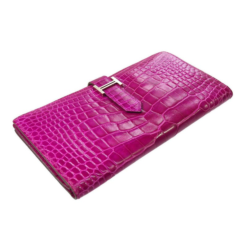 Hermes Hot Pink Alligator Exotic Leather 'H' Logo Palladium Evening Clutch Wallet Bag in Box  Alligator  Palladium hardware Fold in buckle closure Leather lining Date code present Made in France Features zip closure, bill compartment and card slots
