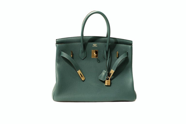 This authentic Hermès Malachite Togo 35 cm Birkin is in very good condition.    Hand stitched by skilled craftsmen, wait lists of a year or more are common for the Hermès Birkin. They are considered the ultimate in luxury fashion. Malachite, like