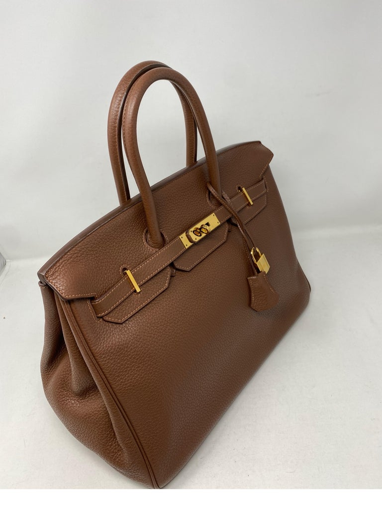 Hermes Maroon D'Inde Birkin 35 Bag. Clemence leather. Gold hardware. #O stamp from 2011. Good condition. A shade darker than gold color on Hermes color chart. Beautiful neutral color. Includes clochette, lock, keys, and dust cover. Guaranteed