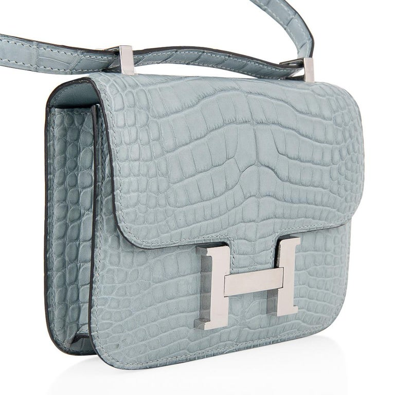 Guaranteed authentic exquisite limited edition Hermes Micro Constance features rare Ciel in Matte Alligator. Fresh with Palladium hardware. Perfect for year round wear. This is a highly collectible Hermes bag. Carried by hand, over the shoulder, or