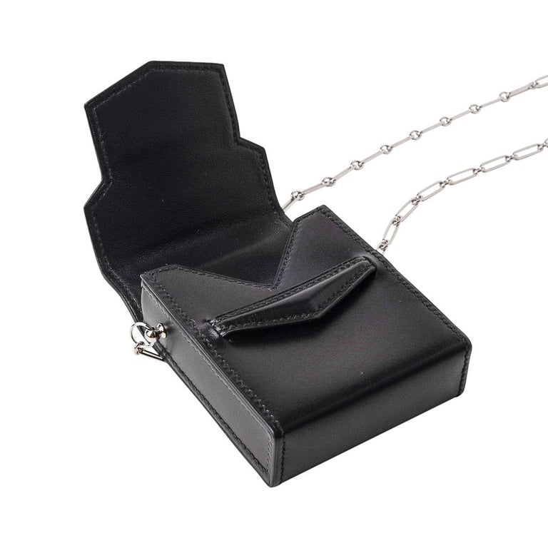 Guaranteed authentic Hermes Runway Limited Edition 70mm Micro Sac features Black Veau Villandry leather. This 3