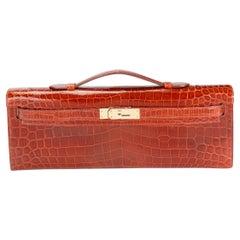 Hermès Miel Shiny Niloticus Crocodile Kelly Cut GHW