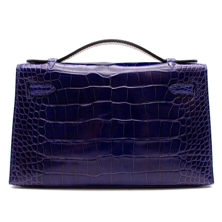 Hermès Kelly Pochette 22 in Blue Electric Lisse Alligator Mississippiensis with Palladium Hardware.  2014  Includes Dust Bag.  Size: Mini Pochette  Please note. This bag does not have its CITES  22 w x 13 h x 6 d cm