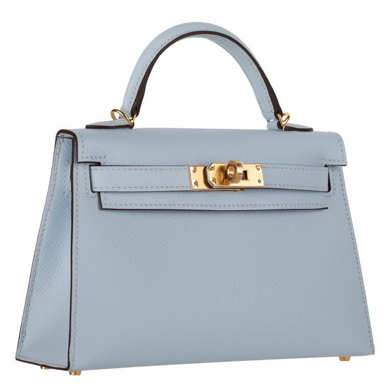 Brand: Hermès  Style: Kelly Size: Mini II Color: Blue Brume Leather: Epsom Hardware: Gold Stamp: 2021 Z  Condition: Pristine, never carried: The item has never been carried and is in pristine condition complete with all accessories.  Accompanied by: