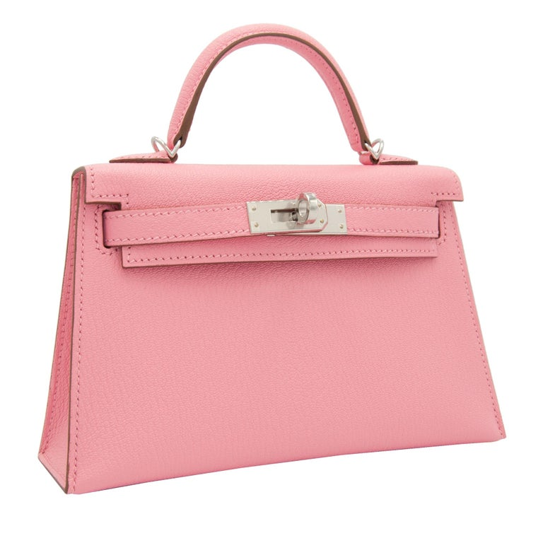 Brand: Hermès  Style: Kelly Size: Mini II Color: Rose Confetti Leather: Chèvre  Hardware: Palladium Stamp: 2020 Y  Condition: Pristine, never carried: The item has never been carried and is in pristine condition complete with all