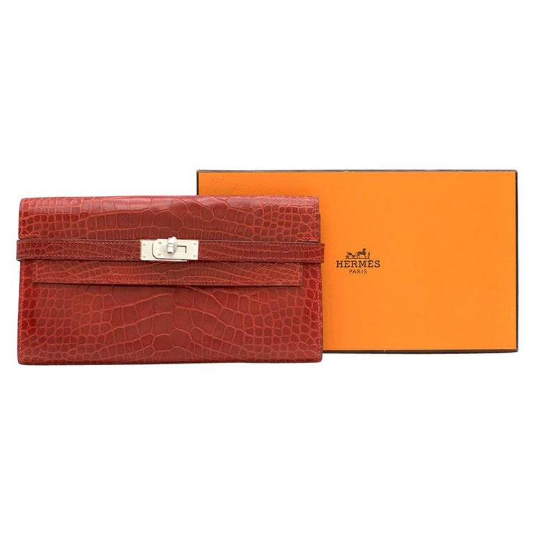 Hermes Alligator Mississippiensis Braise Kelly Classic Wallet  - Age K in a square (Circa 2007)  -Two compartments, two slip pockets, one zip partition, and twelve card holders. - Palladium Hardware - Matte Alligator - Braise red colour - Box