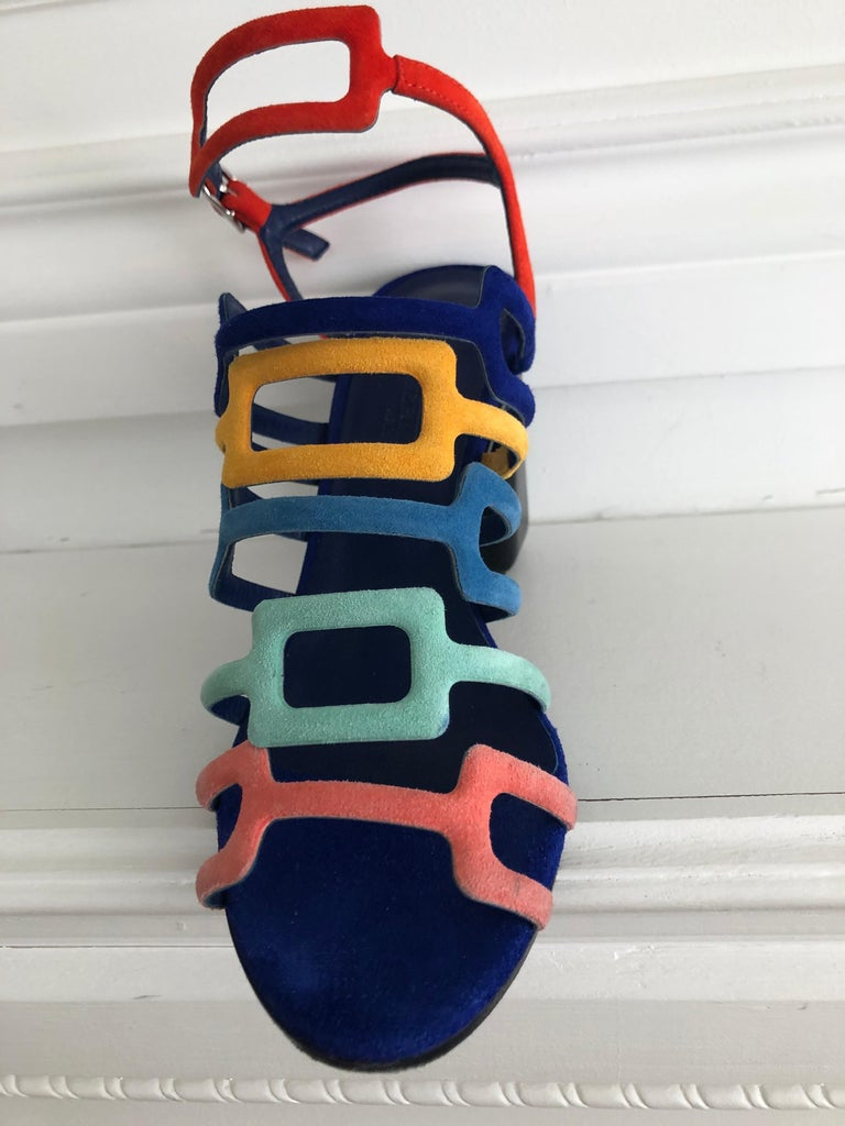 Complete your summer wardrobe with these stunning Hermes sandals. Gladiator sandal style featuring rainbow colour block design in signature goat suede. Ankle strap with silver hardware. Heel hight is 3.75