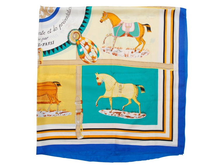 Product details:  Multicolor horse-printed silk scarf by Hermes.  50