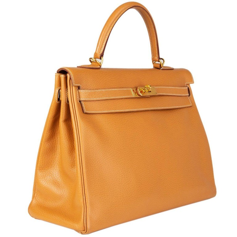 Hermes 'Kelly II 35 Retourner' bag in Naturelle (beige) Vache Ardennes leather with contrasting white stitching. Lined in Chevre (goat skin) with two open pockets against the front and a zipper pocket against the back. Has been carried and with