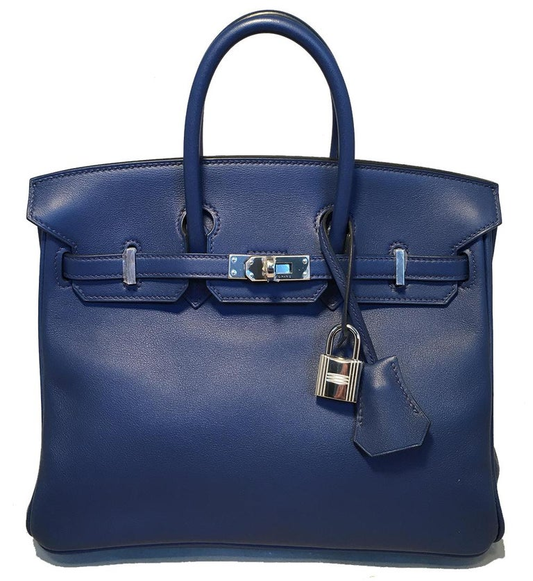 Hermes Navy Blue Swift Leather 25cm Birkin Bag PHW in like new condition. Navy blue swift leather trimmed with silver palladium hardware that still has the protective plastic covering over it. Signature twisting strap and flap closure opens to a