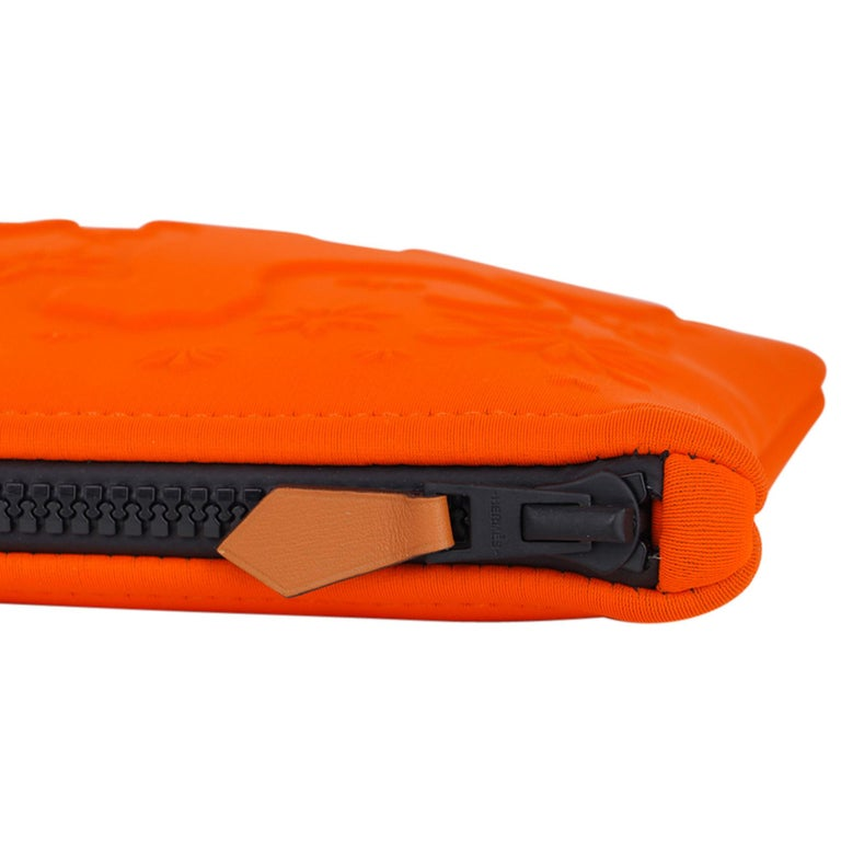 Guaranteed authentic limited edition Hermes Neobain Les Leopards case featured in the small model. Beautiful signature Orange with two leopards embossed on front. Top black zipper with Barenia leather zipper toggle. Water repellent Polyamide and