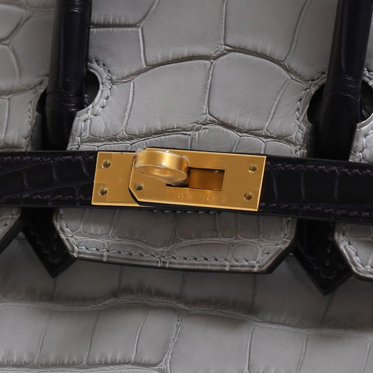 It Gets No Better Than This.  This special order Hermes Birkin 25 bag is the ultimate status symbol for only the most discerning of Hermes collectors. Crafted of exotic crocodile and alligator skins and palladium tone hardware, this gray and purple