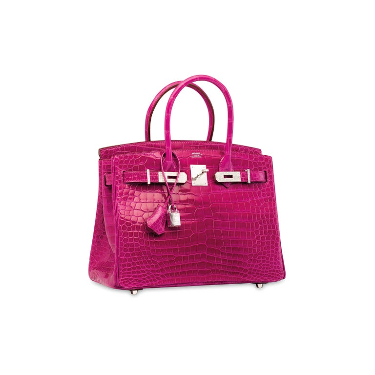 It Gets No Better Than This.  This rare Hermes Crocodile Birkin 25 bag is the ultimate status symbol for only the most discerning of Hermes collectors. Crafted of exotic crocodile skin leather, diamonds and 18Kt white gold hardware, this fuchsia