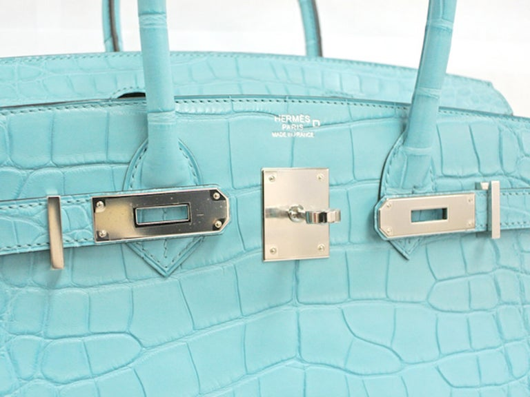 Your Exclusive Exotic Hermes Birkin Has Arrived.    Combining beautiful baby blue matte alligator skin, this brand new Hermes Birkin 30 is a special treat and rare find unlike any other out of the French fashion house. Featuring stunning palladium