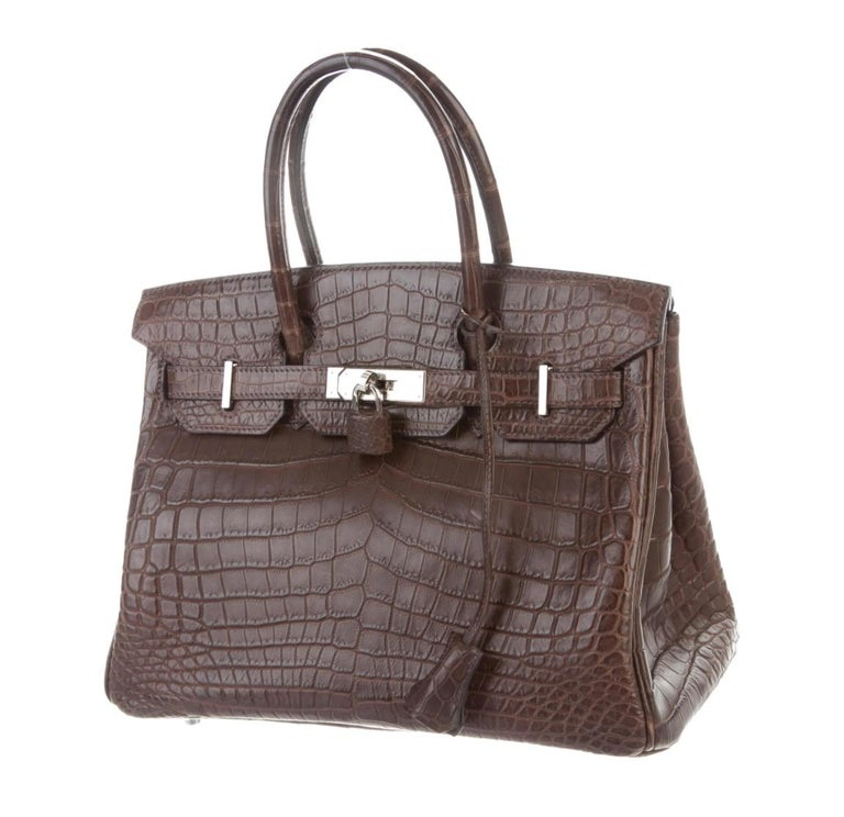 Our Newest Hermes Birkin Has Arrived.     Featuring matte exotic crocodile skin leather, this Hermes Birkin 30 is one of the most coveted Birkin from the French fashion house. Featuring stunning palladium hardware, it's a strikingly beautiful status