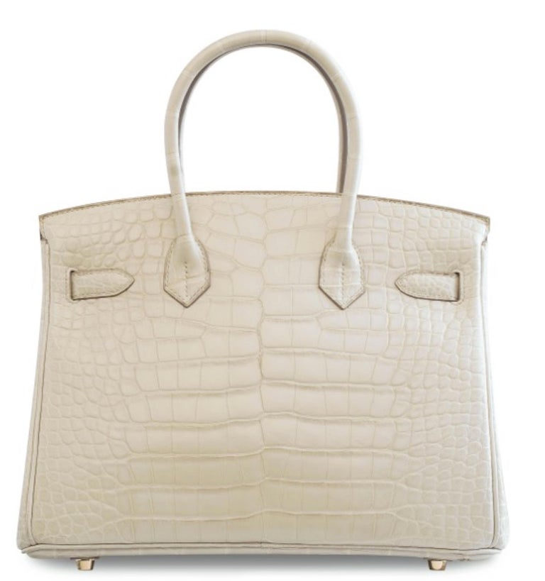 Our Newest Hermes Birkin Has Arrived.     Featuring matte exotic crocodile skin leather, this Hermes Birkin 30 is one of the most coveted Birkin from the French fashion house. Featuring stunning gold hardware, it's a strikingly beautiful status