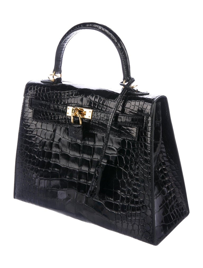 It Gets No Better Than This.  This rare Hermes Crocodile Kelly 25 bag is the ultimate status symbol for only the most serious of Hermes collectors. Crafted of exotic alligator skin leather in richly bold, black, this exclusive Hermes Kelly is brand