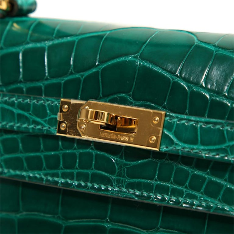 It Gets No Better Than This.  This rare Hermes Crocodile Kelly 25 bag is the ultimate status symbol for only the most serious of Hermes collectors.  Crafted of exotic crocodile skin leather in rich, gemstone green, this exclusive Hermes Kelly is