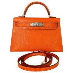 Hermes New Kelly Mini 20 Orange Feu Verso Pink Rose Inside