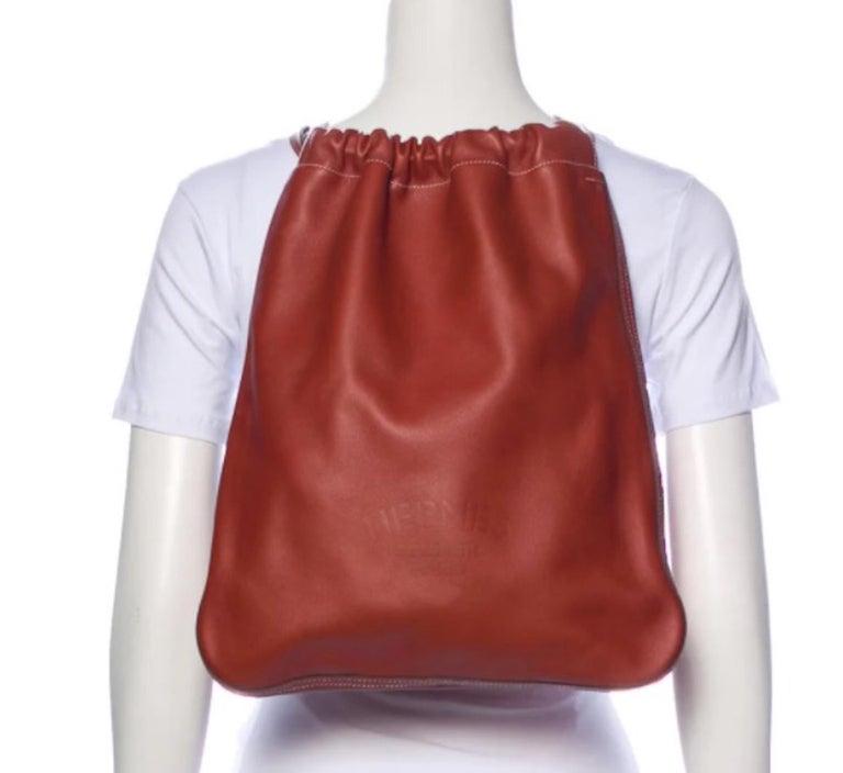 Leather  Palladium-plated hardware Adjustable shoulder straps Suede lining Drawstring closure  Shoulder strap drop 23-27.5