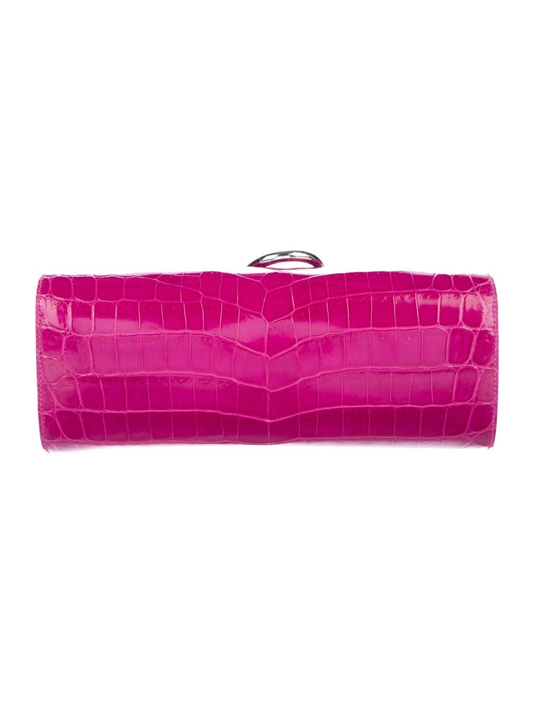 Hermes NEW Magenta Pink Crocodile Exotic Leather Palladium Egee Clutch Flap Bag in Box  Crocodile Palladium-plated hardware Leather lining Magnetic closure Measures 10