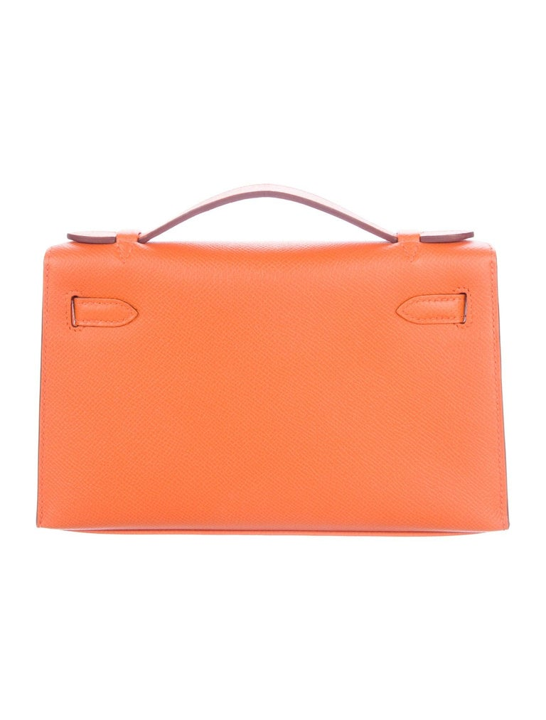 Hermes NEW Orange Leather Gold Kelly Top Handle Satchel Small Pochette Tote Bag in Box  Leather  Gold-plated hardware Leather lining Turn-lock closure  Handle drop 1