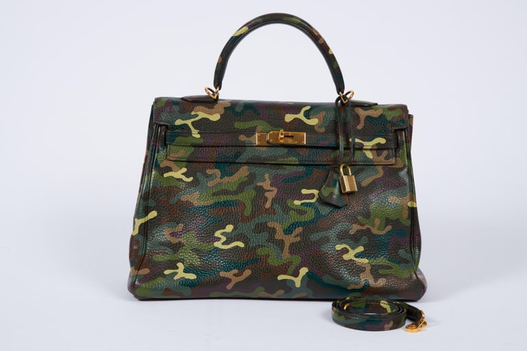 Hermes kelly bag 35 cm retourne in olive green clemence leather and gold tone hardware. One of a kind hand painted camouflage. Detachable strap, 35