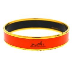 Hermès Orange Gold Tone Bangle Bracelet