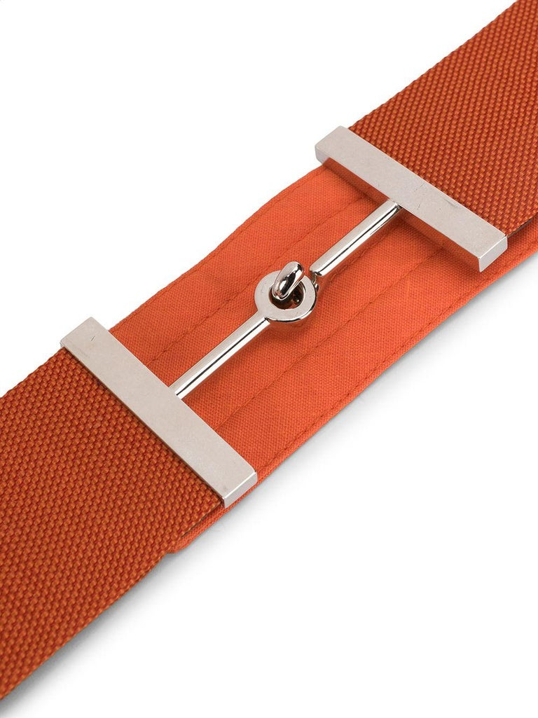Crafted in France from a vibrant orange cotton-blend, this pre-owned belt by Hermès features a hook and eye fastening and a horsebit buckle accented by silver-toned metal hardware.  Colour: Orange/ Silver  Composition: Cotton/ Silver-plated