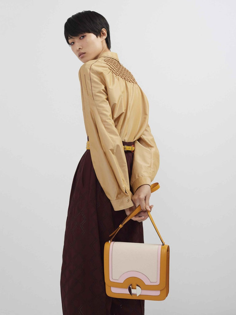 Hermes Orange Pink Leather Canvas  Top Handle Satchel Saddle Shoulder Flap Bag  Leather Canvas Palladium-plated hardware Push-lock closure  Made in France Shoulder strap drop 18