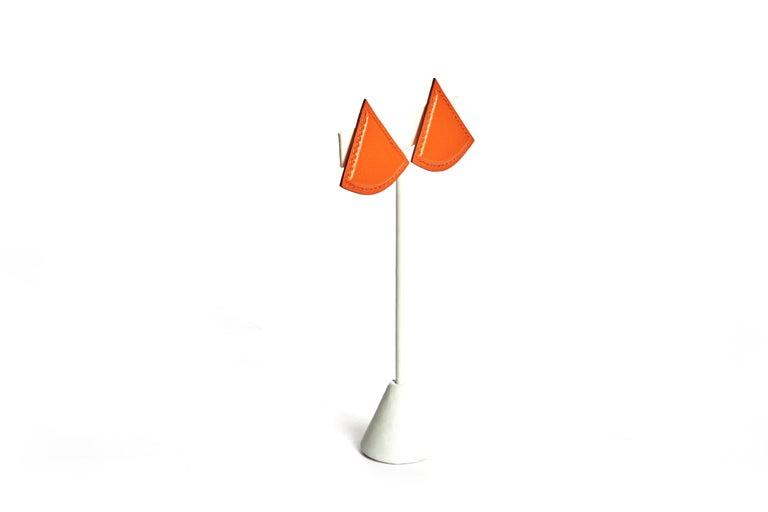 Hermès Paris orange swift leather triangular clip back earrings. Comes in velvet pouch.