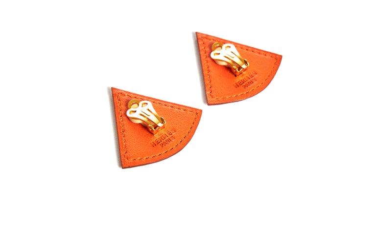 Women's Hermès Orange Swift Triangular Earrings For Sale