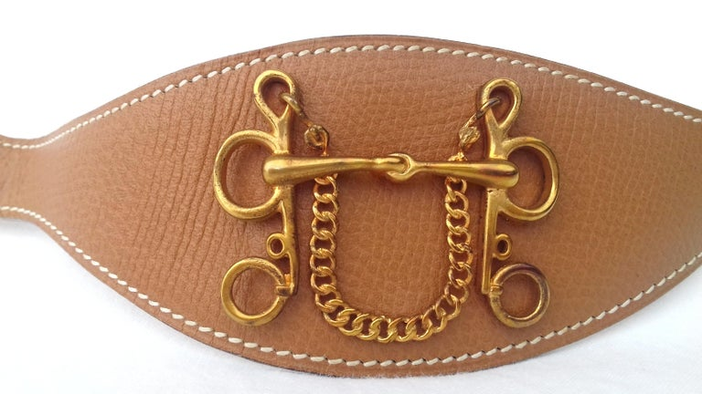 Rare Authentic Vintage Hermès Ornament  This piece of leather is designed to adorn the Hermès skirts and belts designed for this purpose (not included in sale)  The front is decorated with a gold metal H representing a horse's bit. Drawing also