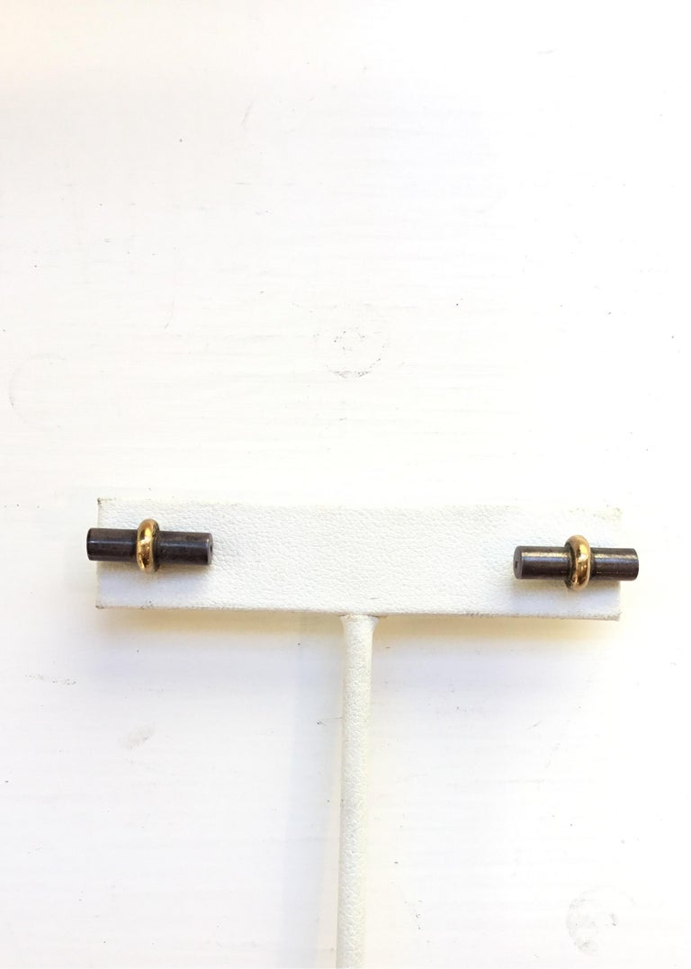 Hermes bar stud pierced earrings with squeeze-insert backs. Earrings are composed of 18k gold and sterling silver.
