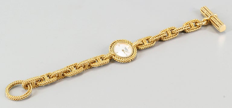 Fine and unusual 18K yellow gold toggle link bracelet watch from the