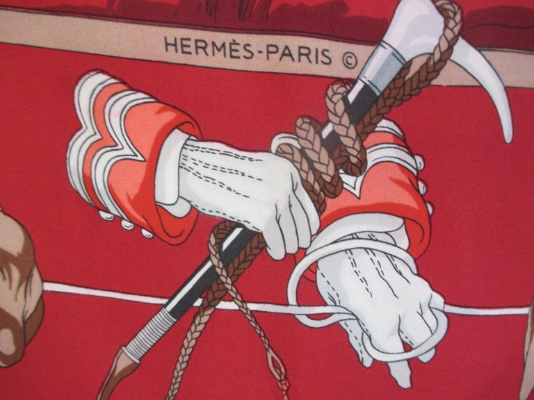 A vintage silk scarf by Hermes styled with classic hunting scene and hound border, on a red background. This Hermès is a true collector's scarf in collector's condition, one to own to wear, show or frame.   Measurements: Length 77cm x Width 80cm