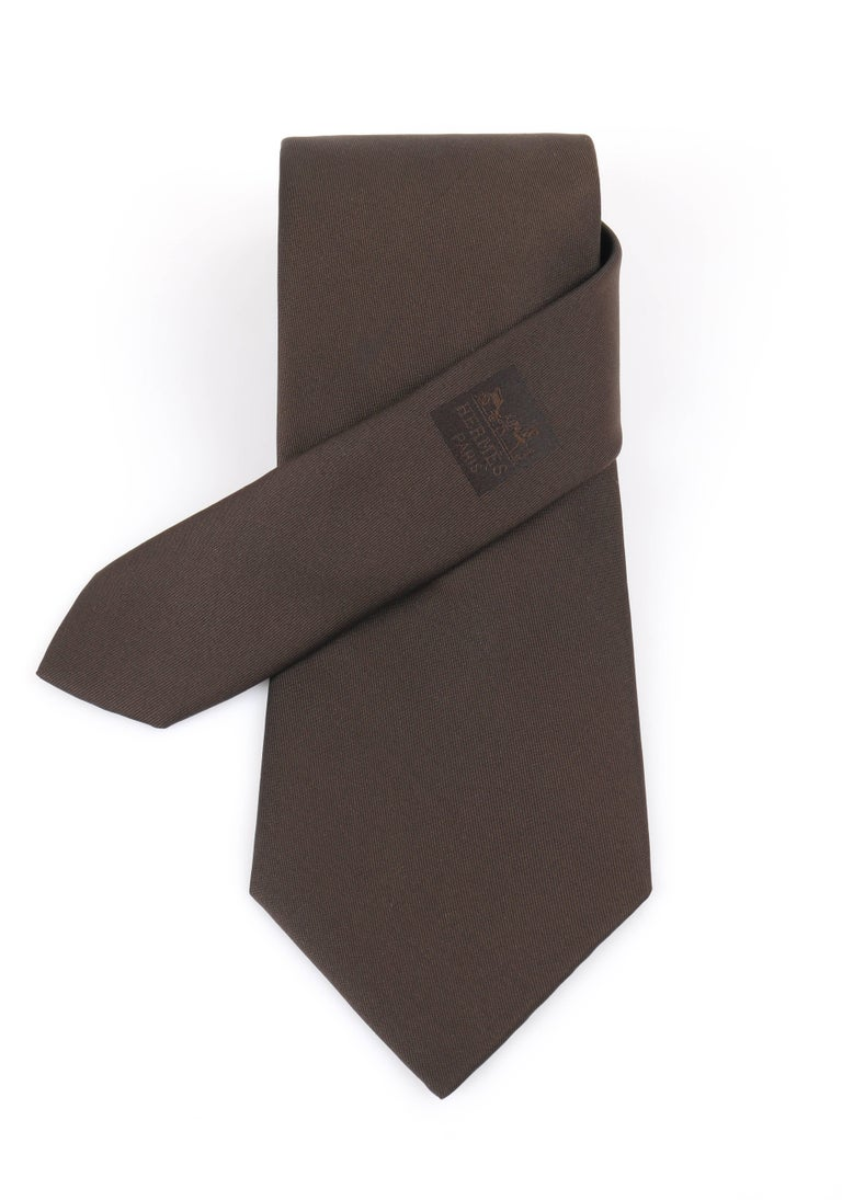 Hermes Paris sold dark brown silk five fold necktie. Solid dark brown silk body.