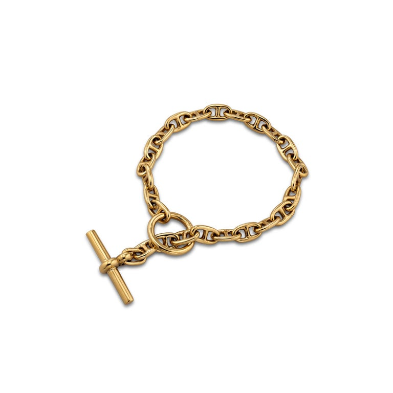 A perfect collectible to stack with all your other bracelets, this 1980's Hermes Paris petite 18 karat yellow gold anchor link bracelet is meant to be worn and admired 24/7.  7