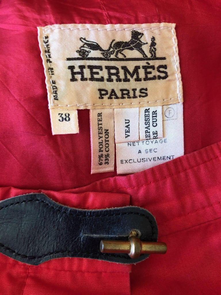 Hermes Paris Vintage Red Polished Cotton Skirt Suit with Signature Details Skirt with jacket, the skirt has leather details at waist and the jacket features Hermes signature link as buttons.. This is so beautifully made,  such attention to detail is