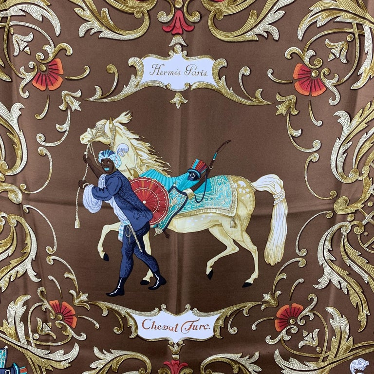 Vintage Hermes silk scarf 'Cheval Turc' scarf designed by Christiane Vauzelles and first issued in 1969. It features an equestrian theme scarf features a man with a turban leading a horse with a brown background. Features hand rolled edges. Approx.