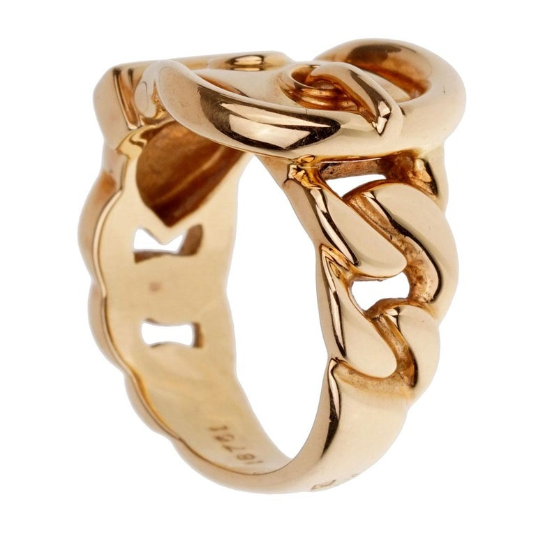 A chic Hermes belt buckle ring in 18k yellow gold.  Size 5 1/2