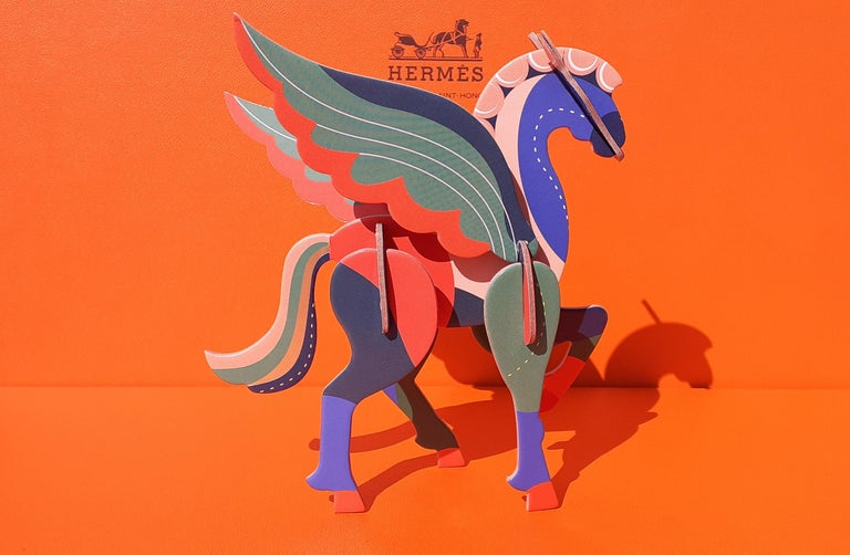 Super Cute Authentic Hermès Pegasus  Composed of 11 pieces of cardboard to assemble  A string will allow to suspend it  The assembly instructions are inside the packaging  Colorways: Pink, Blue, Green, and some golden in the tail !  Measurements
