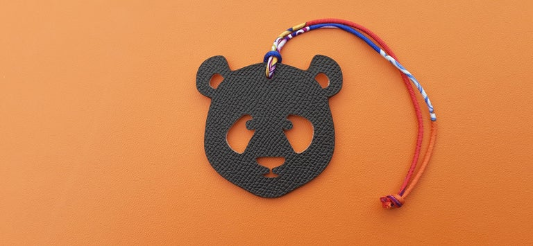 Super Cute Authentic Hermès Charm  Patter: Panda Head  Can be used as Charm for your Bag or your shoe, or as ring to tie your scarf (silk link can be removed  Made of grained leather  Colorways: Light Pink / Brown  Silk Link in red, blue, purple,